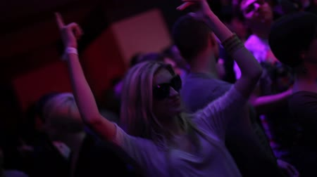 a party : Dancing girl in strobe lights during night club party