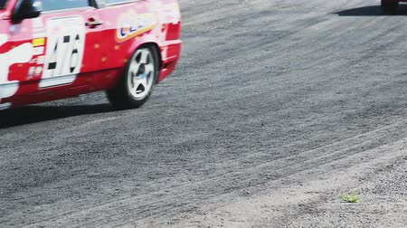 řev : Racing cars lose rubber as they pass by sharp turn on track during competition