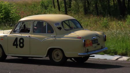 drive : Tiny looking Morris Oxford driving slowly over suburb. Hd quality vintage car
