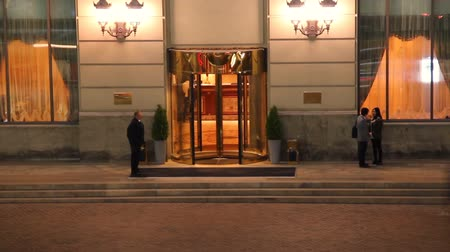 zengin : Elite 5-star hotel entrance at night timelapse visitors come out