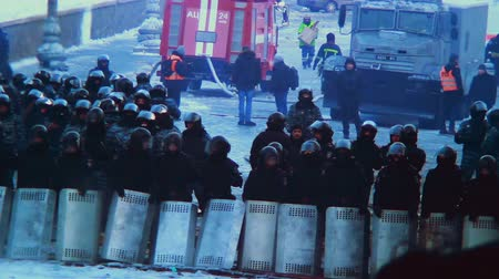 unrest : KIEV, UKRAINE - JANUARY 2014: Revolutionary events on Majdan. Street riot Special Forces shields helmets against crowd winter Stock Footage