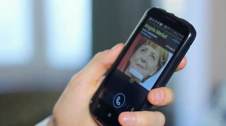 chancellor : German Chancellor Merkel calling US official, phone close-up Stock Footage