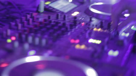 tweaking : Djs hands playing mix on sound board, platter spinning Stock Footage