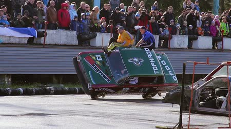 blockbuster : Two-wheel driving, stuntmen climb out of car, extreme stunt show Stock Footage