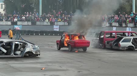 blockbuster : Audience watches car burning, explosion with sound, fire stunt