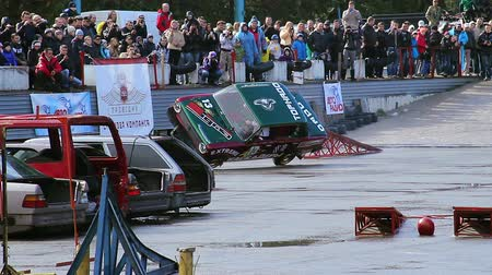 blockbuster : Car driver performing two-wheel driving at extreme stunt show