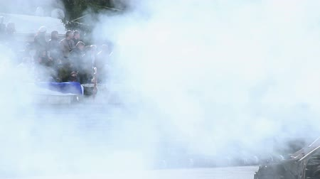 дрейф : Dense smoke hovering above people at extreme car stunt show