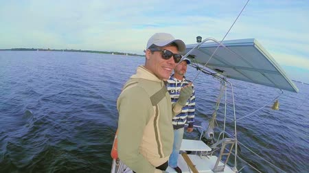 vztahy : Father and son on sailing yacht, quality time, family bonding