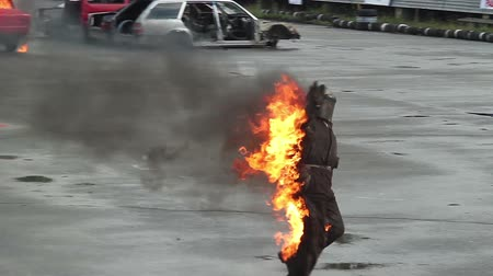 blockbuster : Stuntman escapes burning car, risky fire stunt. Part1of3 Stock Footage