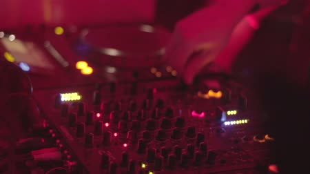 tweak : DJ playing records, mixing tracks, turning controls, nightclub Stock Footage
