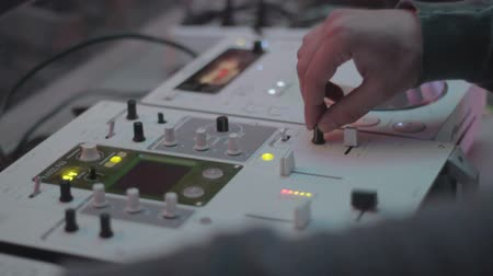 tweak : Male hands mixing sounds, turning controls, professional DJ deck