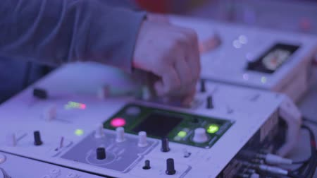 tweak : Male DJ playing music on sound equipment, deck, turntable, club