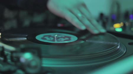 tweak : Deejay hand scratching, spinning platter, playing, mixing melody