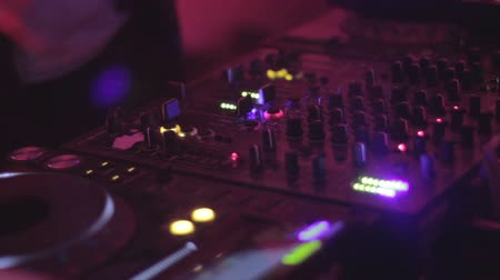 tweak : Disk jockey club performing, hands turning, switching controls Stock Footage