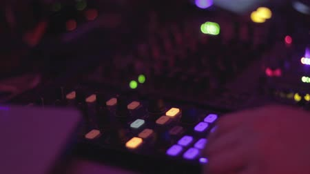 tweak : Disc jockey pressing buttons, tweaking mixer controls, nightclub Stock Footage