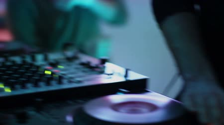 tweaking : Male DJ mixing records, tweaking, pressing buttons, equipment Stock Footage