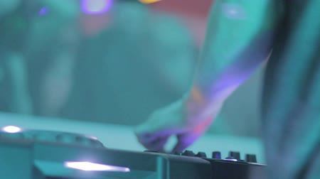 tweak : DJ playing records at night club, people enjoying music, party Stock Footage