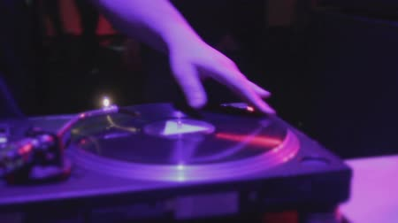tweak : Closeup of deejay hand scratching vinyl record on sound deck