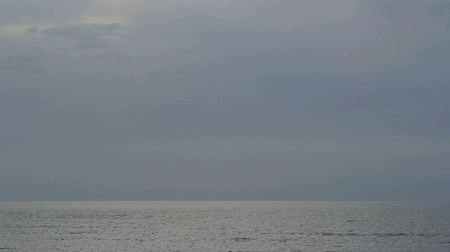 neverending : Time lapse of tranquil open sea with rippling water surface. Calm misty seascape Stock Footage