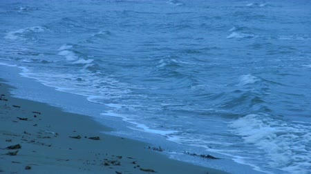 neverending : Loopable shot of waves washing sandy beach. Choppy water surface. Feeling lonely Stock Footage