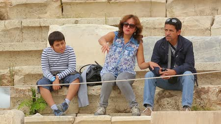 dionysus : Parents and son having rest on old stairs, family recreation on summer vacation