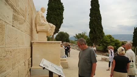dionysus : Tourists view statue of famous ancient Greek dramatist Menandre, sculpture art Stock Footage