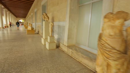 points of interest : Timelapse of person viewing exhibits, statues at ancient Agora museum in Athens Stock Footage