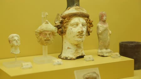 dionysus : Plastic vase in shape of ancient Greek god Dionysus head at Agora museum, Athens