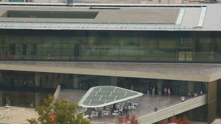 dionysus : Panorama view of new Acropolis Museum, modern glass building, many tourists Stock Footage