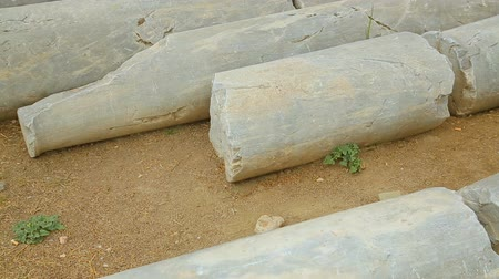 on site research : Pile of antique marble columns at archaeological excavation site, building ruins Stock Footage