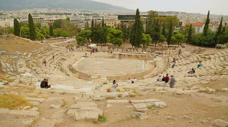 dionysus : Time lapse of many visitors viewing remains of ancient Greek Theater of Dionysus