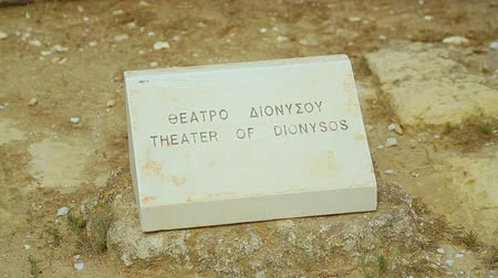 dionysus : Greek and English inscription Theater of Dionysus on stone sign for tourists