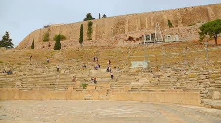 dionysus : Many tourists viewing ancient Theater of Dionysus remains, amphitheater seats