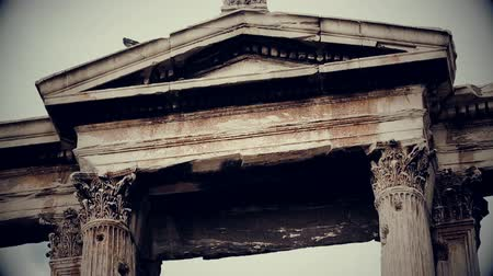 frightful : Vertical pan shot of ancient Greek architecture landmark, black and white film Stock Footage