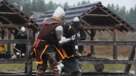 reencenação : Vicious sword fight between two medieval warriors, martial arts competition