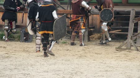 munitions : Actors in medieval suits having break during historical movie shoot, reenactment