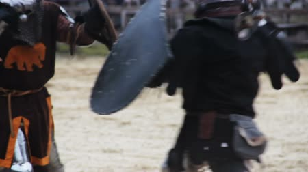 reencenação : Members of knightly orders competing on battle field, martial skills tournament