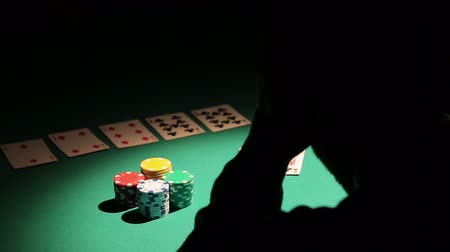 unlucky : Male obsessed with gambling losing all money in poker game, man in despair Stock Footage