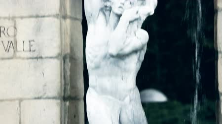 vizcaya : Detailed view of old marble sculpture of a man and two human faces beneath him