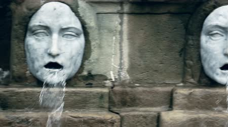 vizcaya : Horizontal pan of two marble fountain sculptures with horrifying grotesque faces Stock Footage