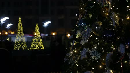 festividades : Festive night on central square of big city decorated with nice New Year trees