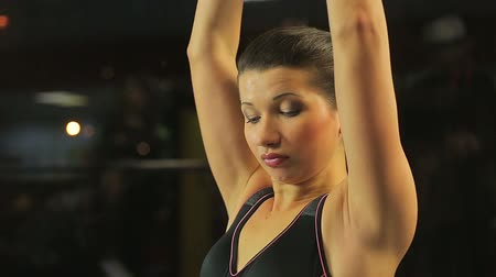 self motivated : Beautiful young woman working hard in gym, doing dumbbell exercise for triceps
