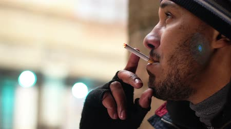 obsessive : Man lighting up cigarette, smoking tobacco in public place, unhealthy habit Stock Footage