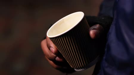 deprived : Miserable poor man begging for charity donation with paper cup in hands, poverty Stock Footage