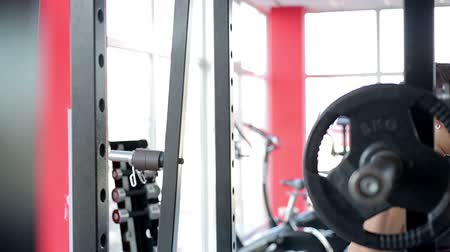 self motivated : Motivated sportswoman squatting with heavy barbell on shoulders, active workout Stock Footage