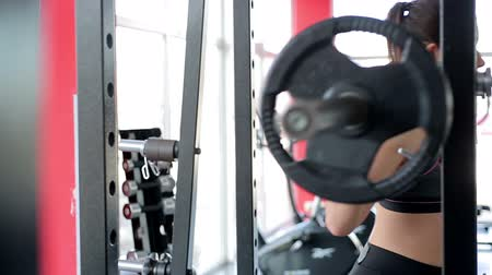 self motivated : Female athlete with muscular body training in gym before sports competition