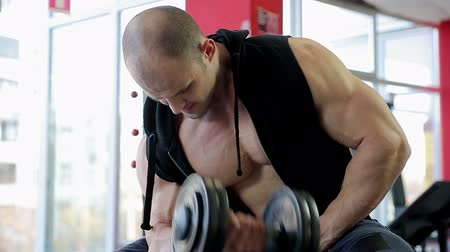 self motivated : Muscular male athlete training hard in the gym, pumping iron to build muscles