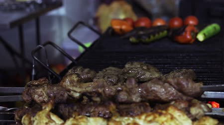 zararlı : Greasy fried meat on charcoal grill, unhealthy food detrimental to health, BBQ Stok Video