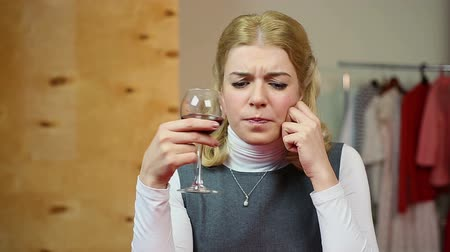 pained : Tired sad woman having problems, drinking red wine. Depression and anxiety