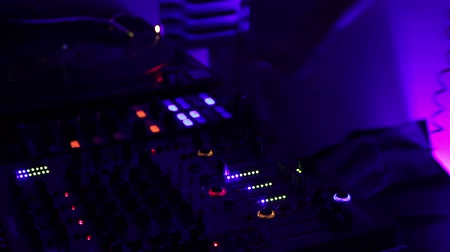 kontrol listesi : DJ hand pushing buttons on audio mixer. Person playing music. Night club